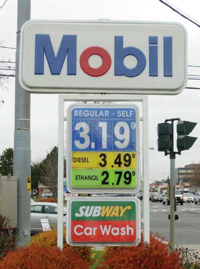 A sign showing gas prices at a Mobil gas station in Colonie, NY on November 22, 2010.  (Lori Van Buren / Times Union) Photo: Lori Van Buren