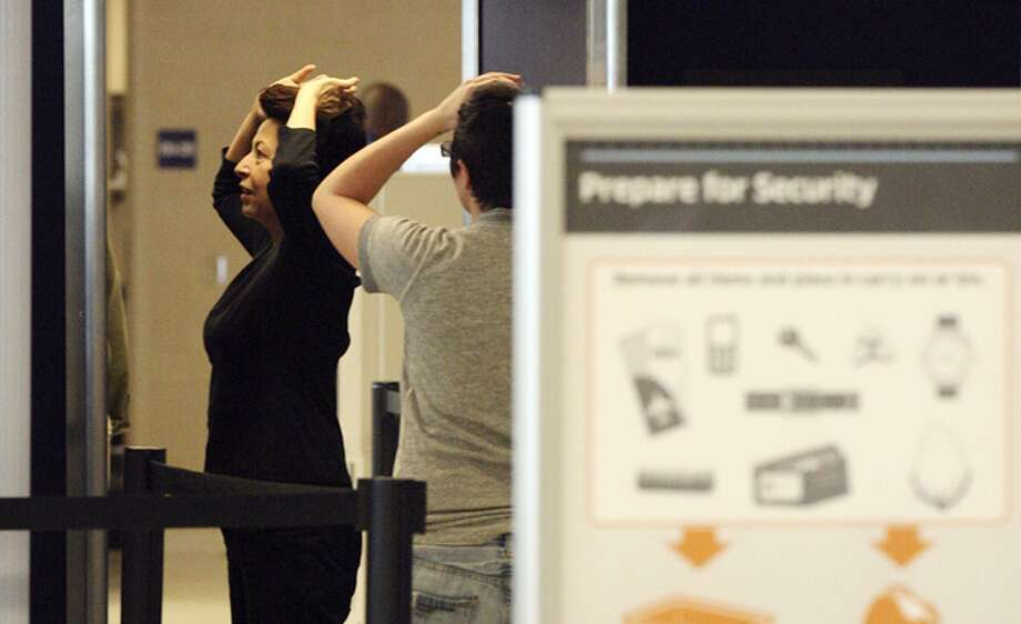 Travelers go through full-body scanners at San Antonio International Airport. Protesters plan to be there Wednesday to express concerns about new search procedures.