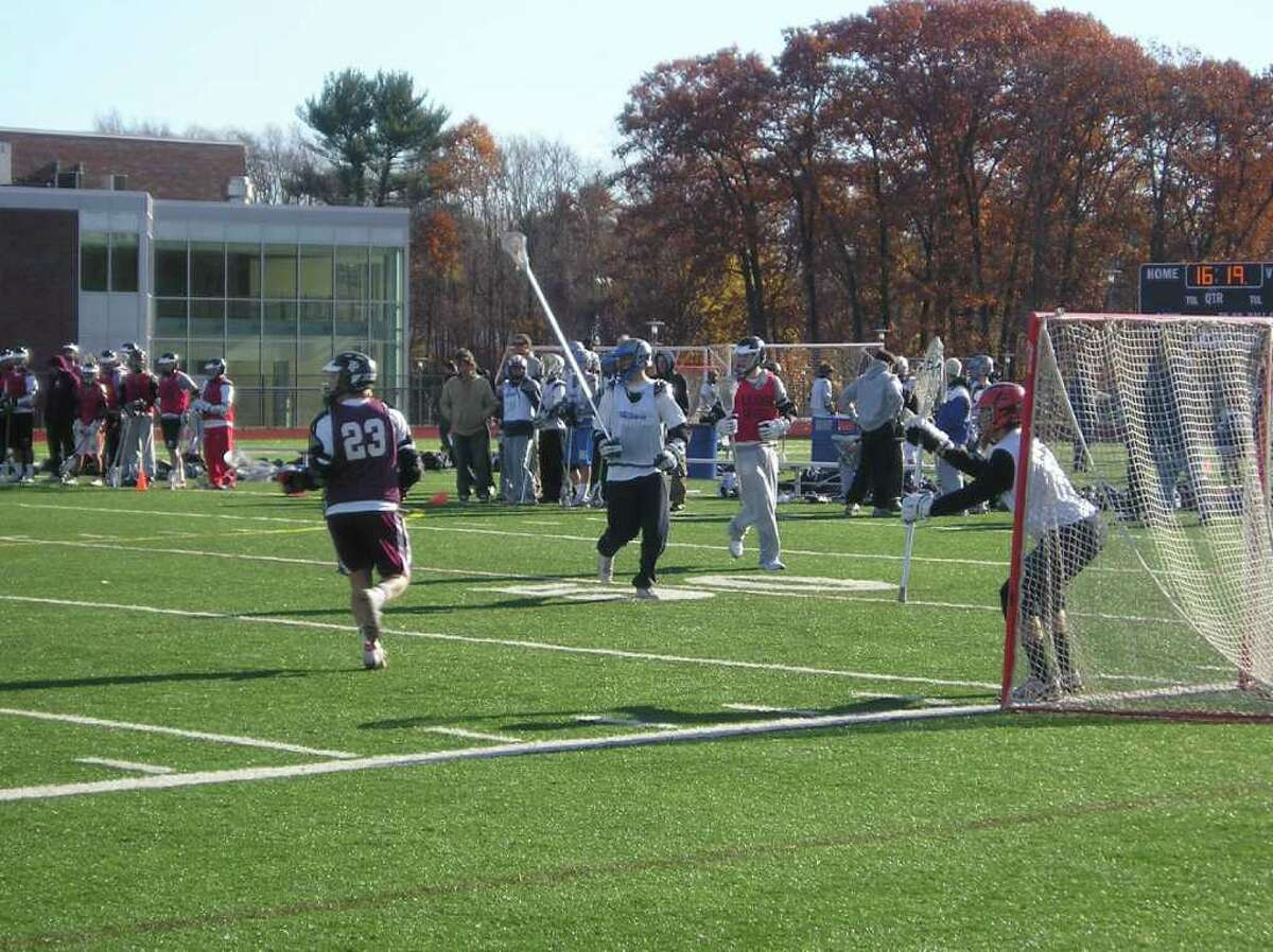 Game action from the 2009 Fairfield Ludlowe boys lacrosse Sticks for Soldiers charity tournament to raise money for wounded warriors. The 2010 tournament will benefit a Staten Island native, Army Specialist Brendan Marrocco, who lost all four limbs and suffered other serious injuries while serving in Iraq in 2009. The tournament will take place at Ludlowe High School on Nov. 27, 2010, starting at 9 a.m.