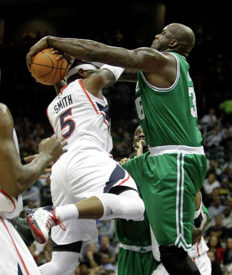 Boston Celtics center Shaquille O'Neal, right, goes up against Atlanta Hawks power forward Josh Smith (5) during the first quarter of an NBA basketball game Monday, Nov. 22, 2010 in Atlanta. (AP Photo/David Goldman) Photo: David Goldman, STF / AP