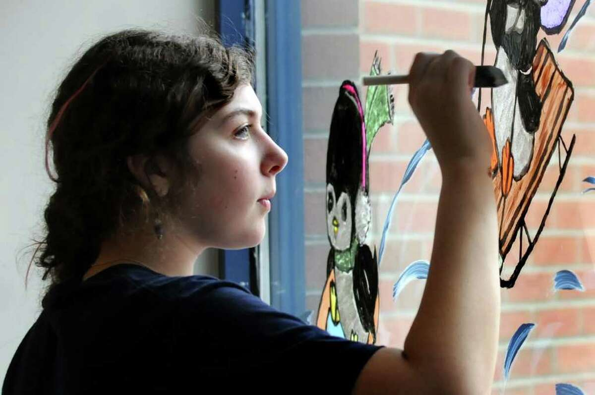 St. Ambrose School eighth-grader Shannon Donovan, 13, paint a holiday scene in the entryway on Tuesday, Nov. 23, 2010, at the Main Post Office in Latham, N.Y. This is the 11th year that the students have painted the windows. (Cindy Schultz / Times Union)