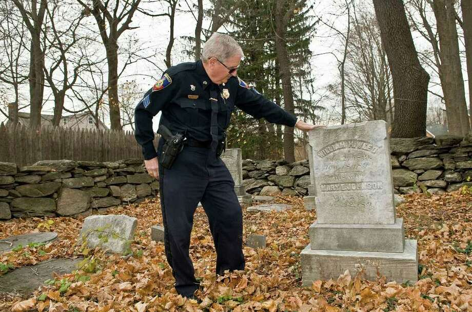 Sgt. Cliff Weed visits a cemetery where his forebears are buried off of High Ridge Road in Stamford on Tuesday, November 23, 2010. Weed has compiled a 1,000-page compendium about his family's history in Stamford and the area. Photo: Shelley Cryan / Shelley Cryan freelance; Stamford Advocate Freelance