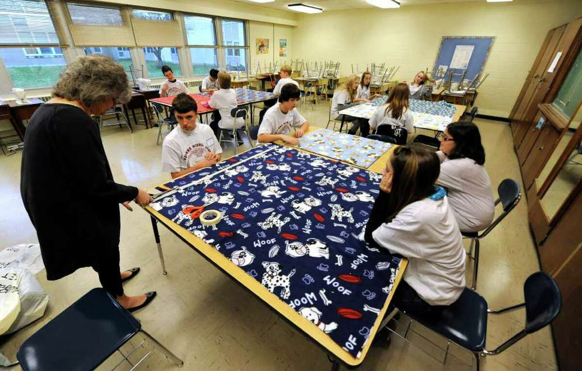 Eighth-grade students at the O'Rourke Middle School in Burnt Hills work on no-sew blankets to be distributed to The Children's Hospital at Albany Medical Center Hospital on the occasion of Service Day at the school November 23, 2010. (Skip Dickstein/Times Union)