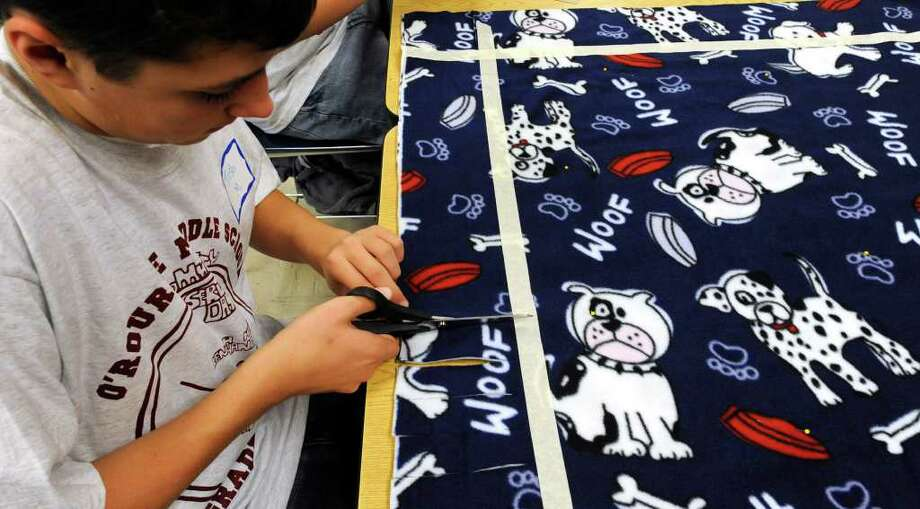 Eighth-grade student Josh Moeckel of O'Rourke Middle School in Burnt Hills works on no-sew blankets to be distributed to The Children's Hospital at Albany Medical Center Hospital on the occasion of Service Day at the school  November 23, 2010. (Skip Dickstein/Times Union) Photo: Skip Dickstein / 2008