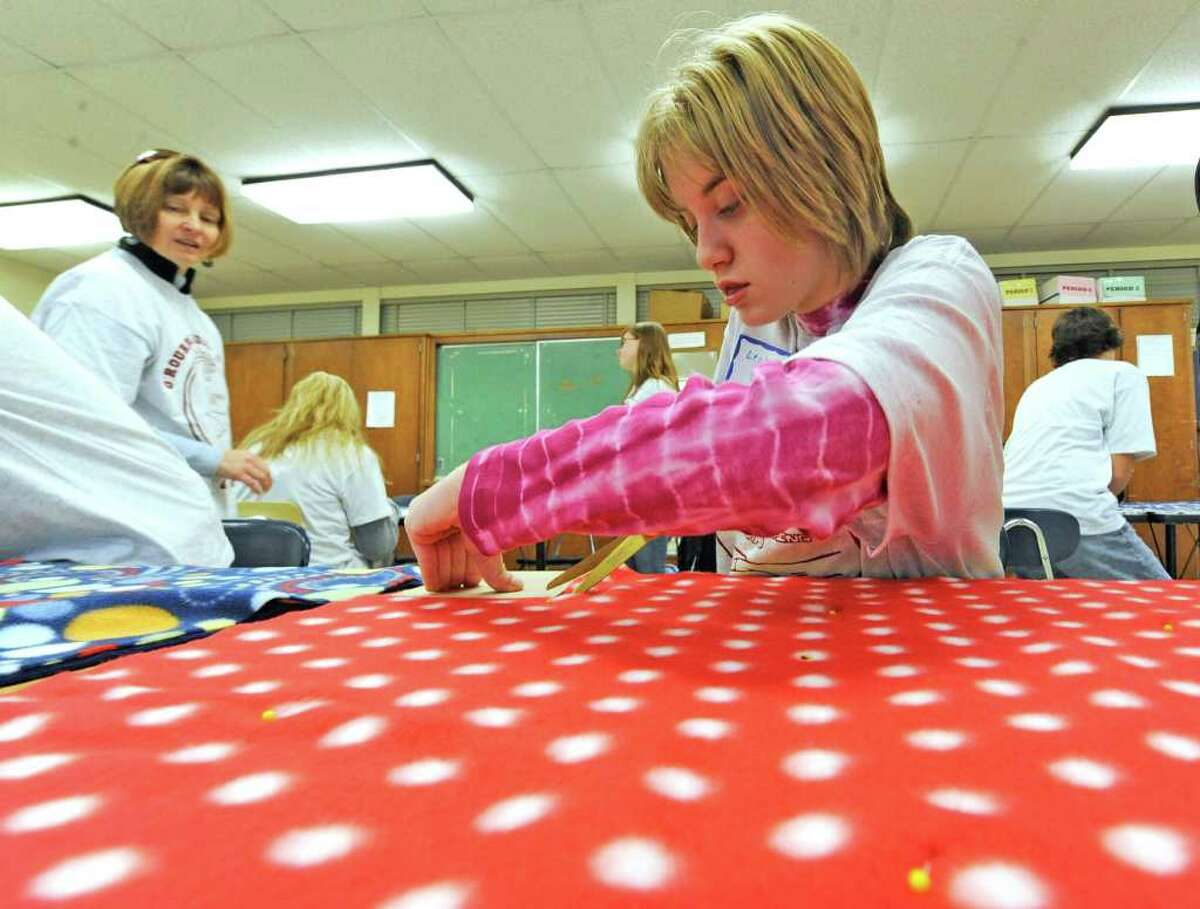 Eighth-grade student Leah Cerrone of O'Rourke Middle School in Burnt Hills works on no-sew blankets to be distributed to The Children's Hospital at Albany Medical Center Hospital on the occasion of Service Day at the school November 23, 2010. (Skip Dickstein/Times Union)