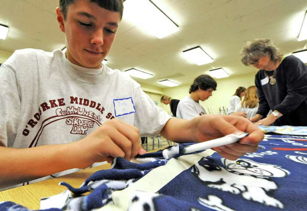 Eighth-grade student Josh Moeckel of the O'Rourke Middle School in Burnt Hills works on no-sew blankets to be distributed to The Children's Hospital at Albany Medical Center Hospital on the occasion of Service Day at the school November 23, 2010. (Skip Dickstein/Times Union)
