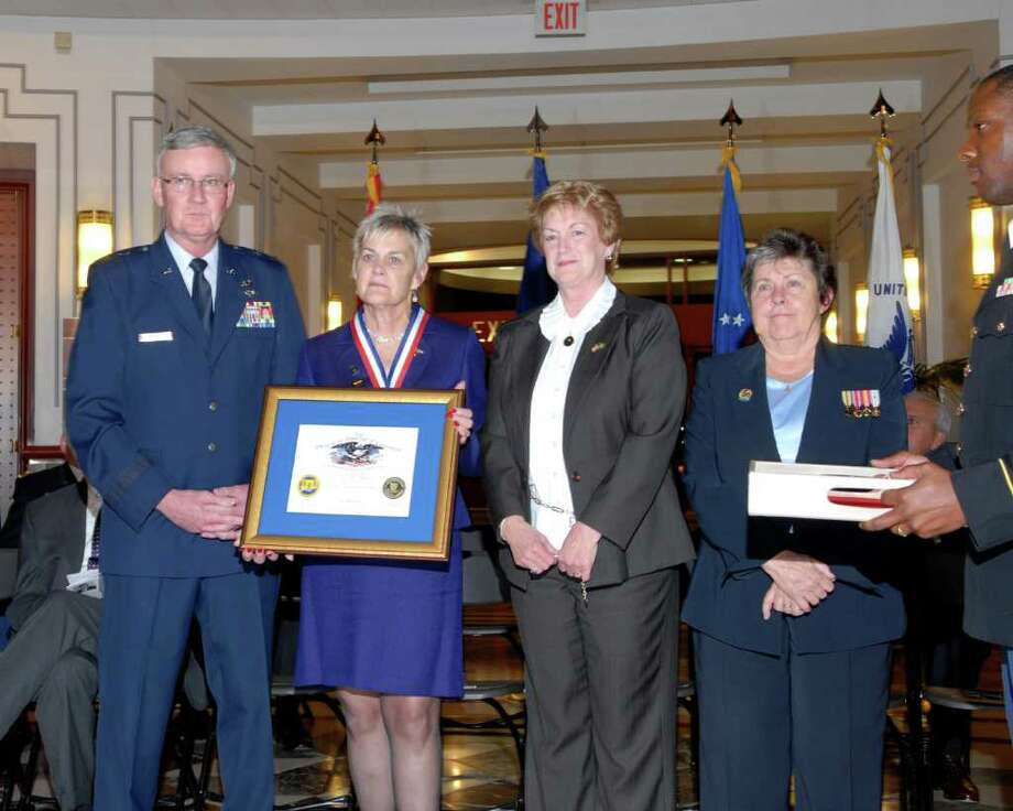 Gathered at the Legislative Office Building in Hartford on Monday, Nov. 22, 2010, to honor the 2010 inductees to the Connecticut Veterans Hall of Fame are, from left, Connecticut National Guard Adjutant General Thaddeus Martin, Doris Troth Lippman of Westport, Gov. M. Jodi Rell, and Connecticut Department of Veterans Affairs Commissioner Linda Schwartz. Photo: Contributed Photo / Westport News contributed