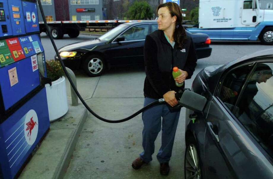 Amanda Simpson, of Danbury, fills her car with gas at the Backus Avenue Mobil station Nov. 23, 2010. Photo: Chris Ware / The News-Times