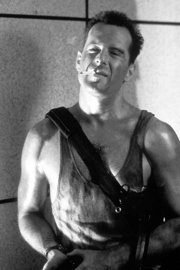 "Bruce Willis plays a police detective fighting terrorists in a Los Angeles skyscraper in the action movie ""Die Hard."""