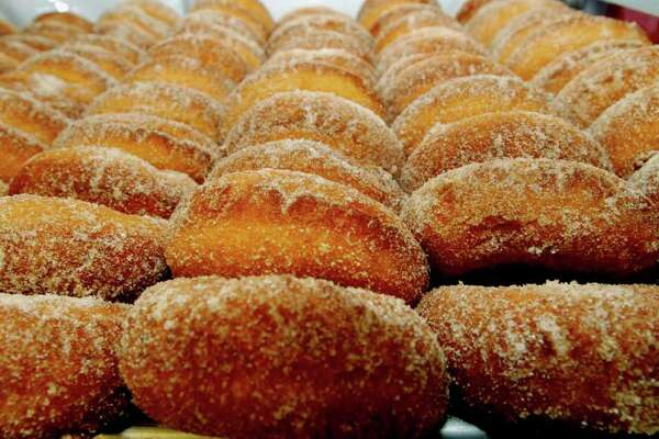 Cider doughnuts are a local favorite and widely available. (Luanne M. Ferris / Times Union)