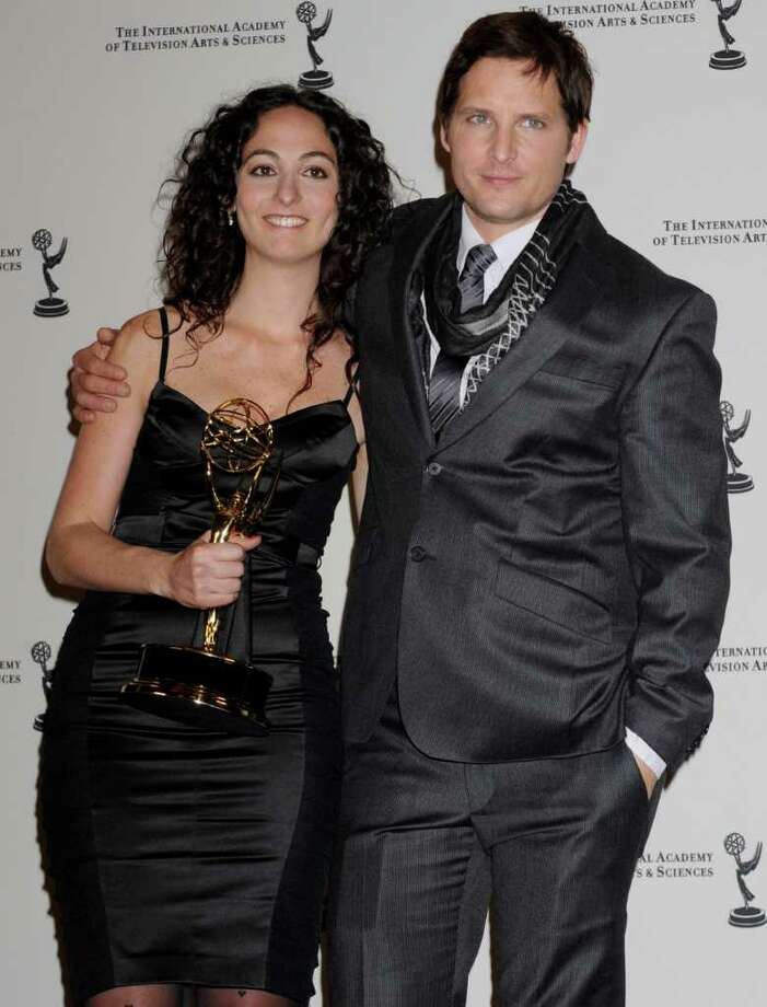 Julieta Shama poses with actor and presenter Peter Facinelli with her award for Non Scripted Entertainment at the 38th International Emmy Awards, Monday, Nov. 22, 2010, in New York. (AP Photo/Louis Lanzano) Photo: Louis Lanzano