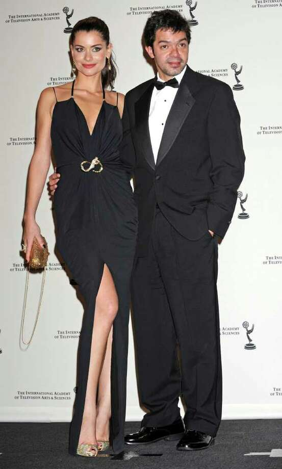 Brazilian actors and presenters Alinne Moraes and Bruno Mazzeo poses in the press room at the 38th International Emmy Awards, Monday, Nov. 22, 2010, in New York. (AP Photo/Louis Lanzano) Photo: Louis Lanzano