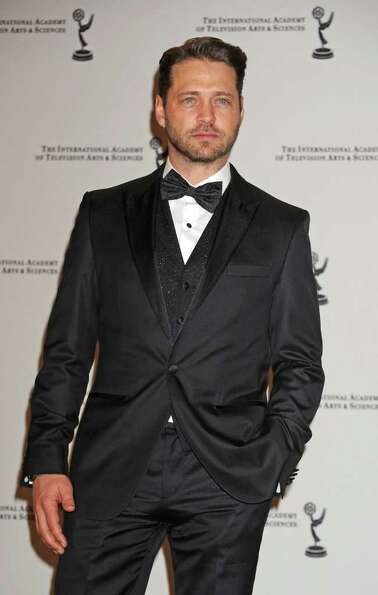 Actor and presenter Jason Priestley poses in the press room at the 38th International Emmy Awards, M