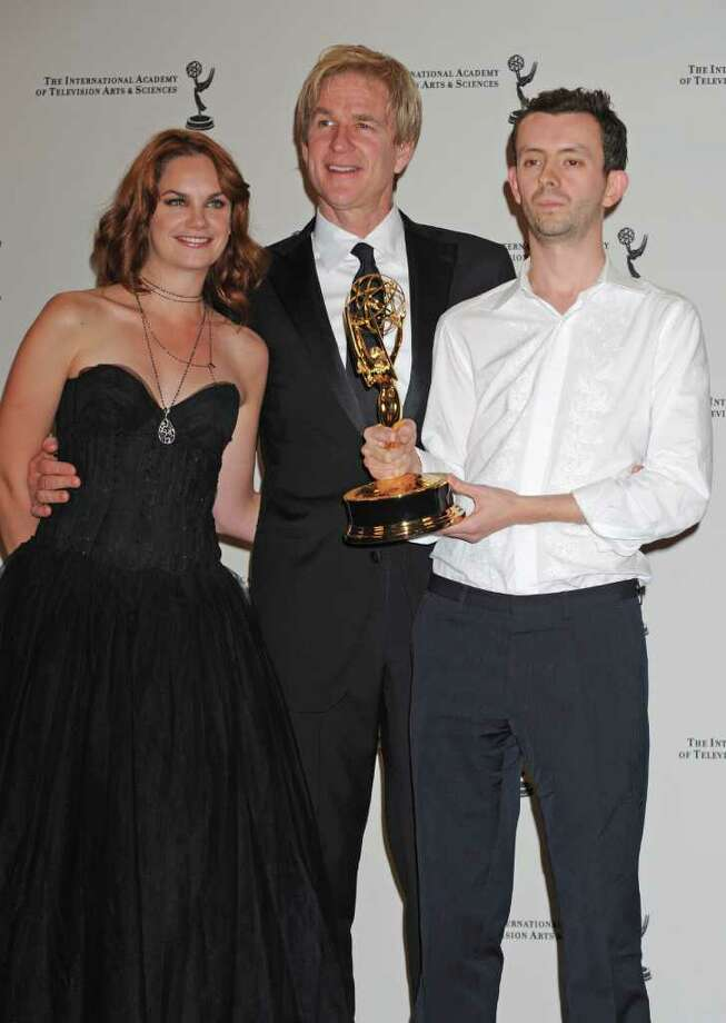 "Ben Stephenson poses after receiving his award for the TV movie mini series ""Small Island"" with actress Ruth Wilson and actor Mathew Modine, center, at the 38th  International Emmy Awards, Monday, Nov. 22, 2010, in New York.  (AP Photo/Louis Lanzano) Photo: Louis Lanzano"