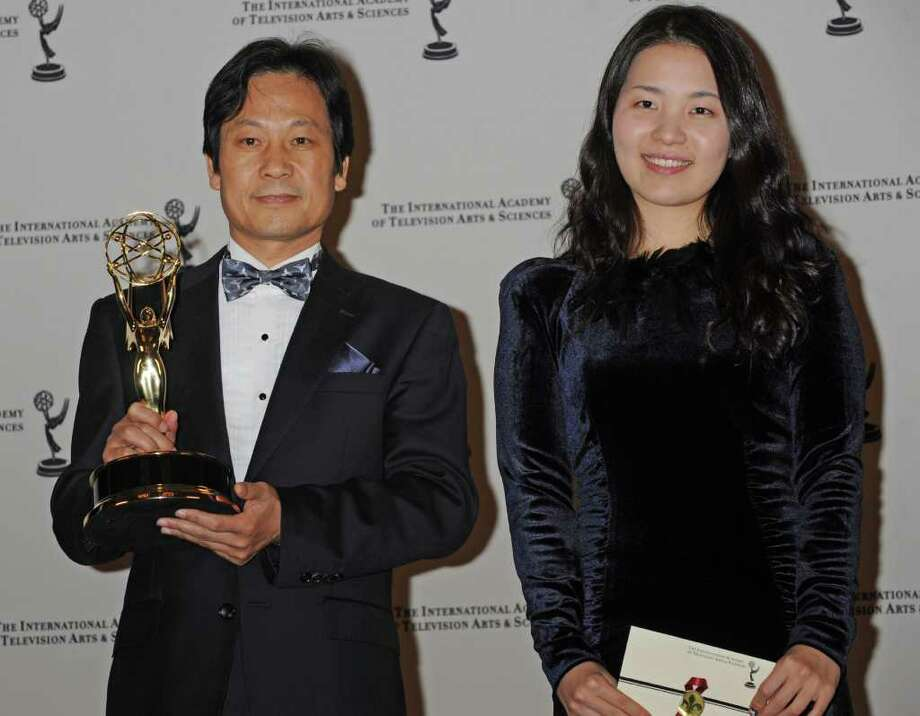 "Jong Hyun Lee poses with his award for Best Documentary ""Mom and The Red Bean Cake""  with Ayuna Park at the 38th  International Emmy Awards, Monday, Nov. 22, 2010, in New York.  (AP Photo/Louis Lanzano) Photo: Louis Lanzano"