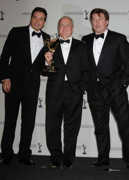 Lorn Michaels poses with his Best Directorate award with presenter Jimmy Fallon, left, and Alec Bald