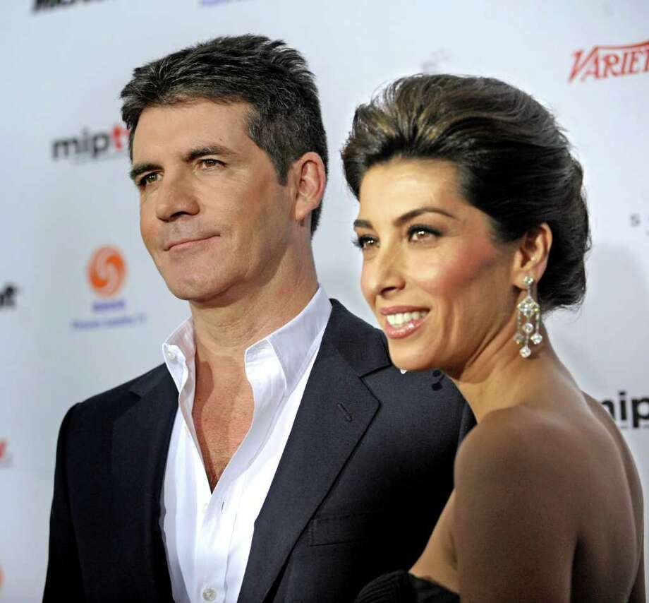 Award recipient and presenter Simon Cowell  arrives with Mezhgan Hussainy at the 38th International Emmy Awards, Monday, Nov. 22, 2010, in New York. (AP Photo/ Louis Lanzano) Photo: Louis Lanzano