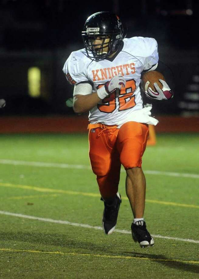 Stamford's Guarien Horton carries the ball during Friday's game against Stamford High School at Fairfield Warde High School on November 5, 2010. Photo: Lindsay Niegelberg, ST / Connecticut Post