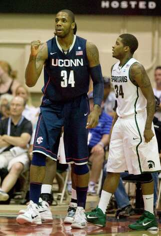 Connecticut's Alex Oriakhi (34) reacts after being fouled on a shot attempt as Michigan State guard Korie Lucious (34) looks on in the first half of a NCAA college basketball game at the Maui Invitational in Lahaina, Hawaii Tuesday, Nov. 23, 2010.  (AP Photo/Eugene Tanner) Photo: AP
