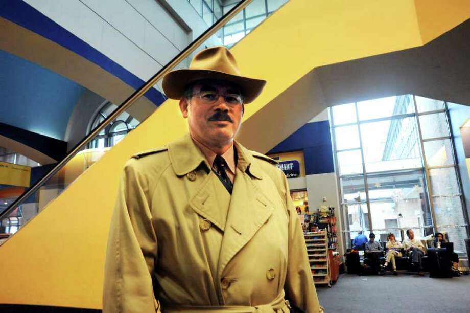 Romero Iral, assistant federal security director for Transportation, and Security Administration, watches the security in the Westchester County Airport, in White Plains, N.Y. on Tuesday, Nov.23, 2010. Photo: Helen Neafsey / Greenwich Time