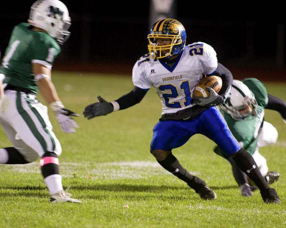 Brookfield's Leaon Gordon (21) cuts back, but New Milford's Valdir Nepomuceno is waiting for him during their SWC game Friday night, Oct. 22, 2010, at New Milford High School. Photo: Barry Horn / The News-Times Freelance