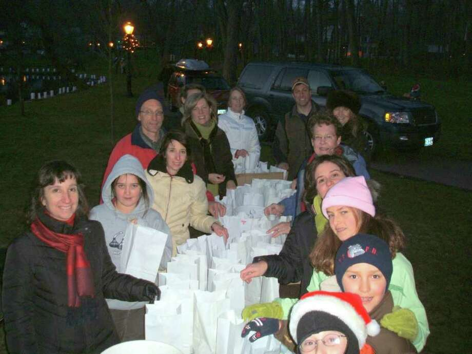 Troop 53 takes part in a luminary lighting project. Photo: Contributed Photo / Darien News