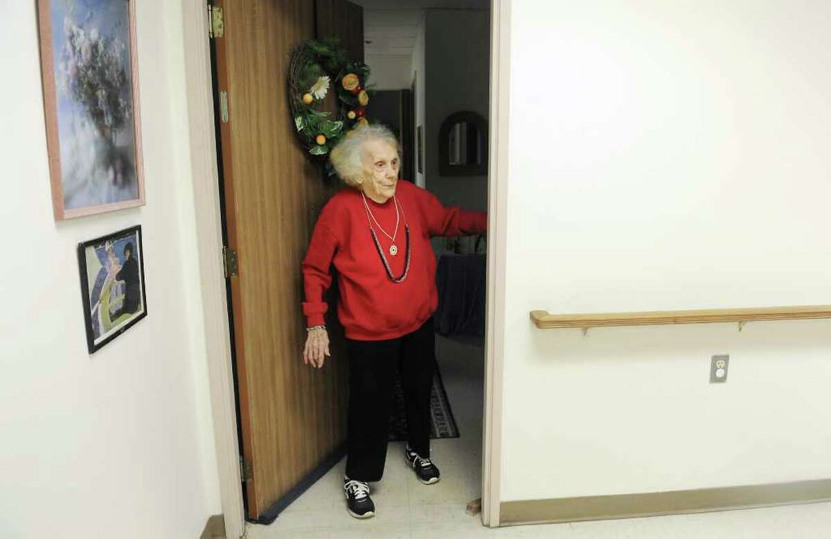 Jean Tyrcyk walks out of apartment #5, where she has lived for 19 years, into the community area at Belltown Manor in Stamford, Conn. on Tuesday November 23, 2010.