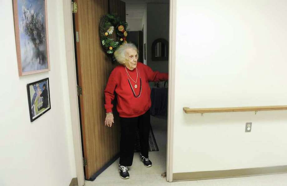 Jean Tyrcyk walks out of apartment #5, where she has lived for 19 years, into the community area at Belltown Manor in Stamford, Conn. on Tuesday November 23, 2010. Photo: Kathleen O'Rourke / Stamford Advocate