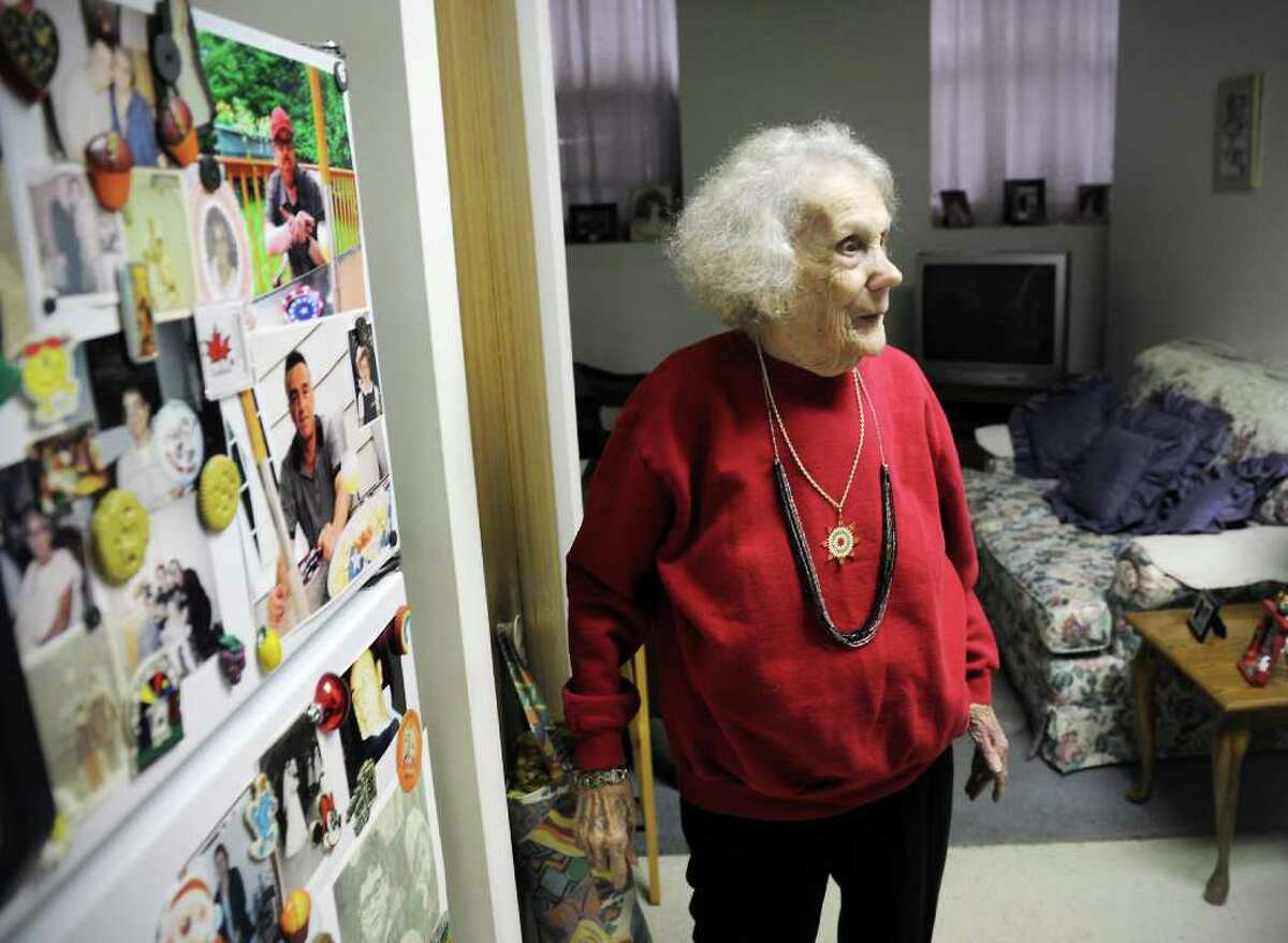 Jean Tyrcyk's refridgerator is covered with family photos in her apartment at Belltown Manor in Stamford, Conn. on Tuesday November 23, 2010.