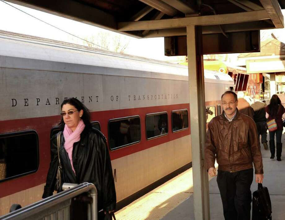 Commuters taking the train at the Danbury train station in this 2009 file photo. Photo: File Photo / The News-Times File Photo
