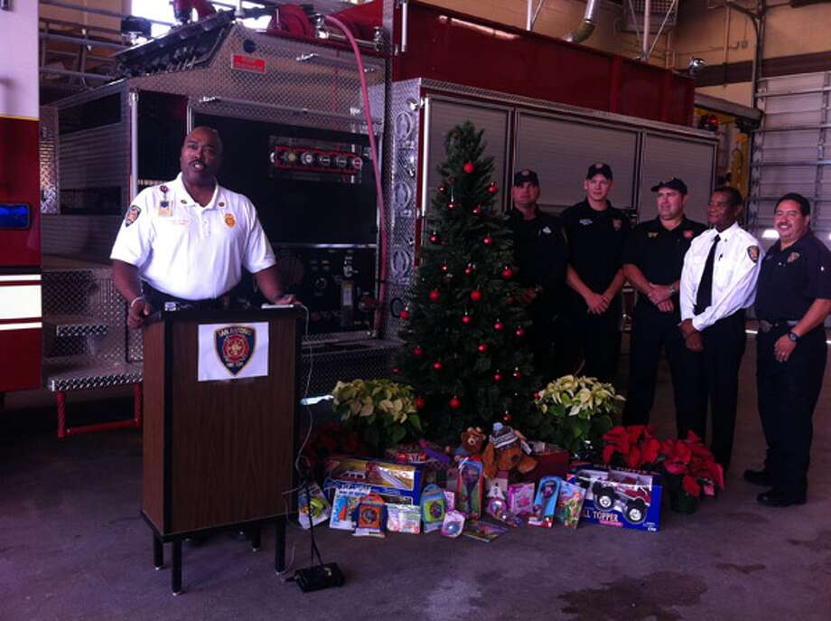 San Antonio Fire Department Chief Charles Hood and other firefighters announce the start of the department's annual toy drive. New, unwrapped toys will be accepted at local fire stations beginning Friday.
