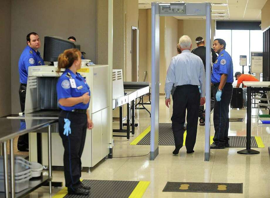 Passengers walk through security at the Jack Brooks Regional Airport recently. Guiseppe Barranco/The Enterprise Photo: Guiseppe Barranco / Beaumont