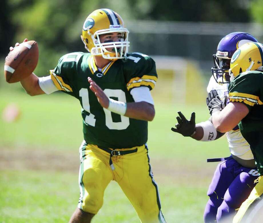 Trinity Catholic High School's quarterback Patrick Murphy looks to throw against Westhill High School in city rivalry football action at Trinity in Stamford, Conn. on Saturday October 2, 2010. Photo: Kathleen O'Rourke, ST / Stamford Advocate