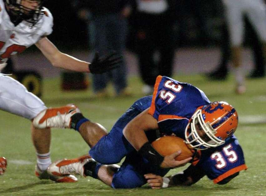 Danbury's 35, Austin Calitro holds onto the ball during the football game against Ridgefield at Danbury High School Nov. 24, 2010.