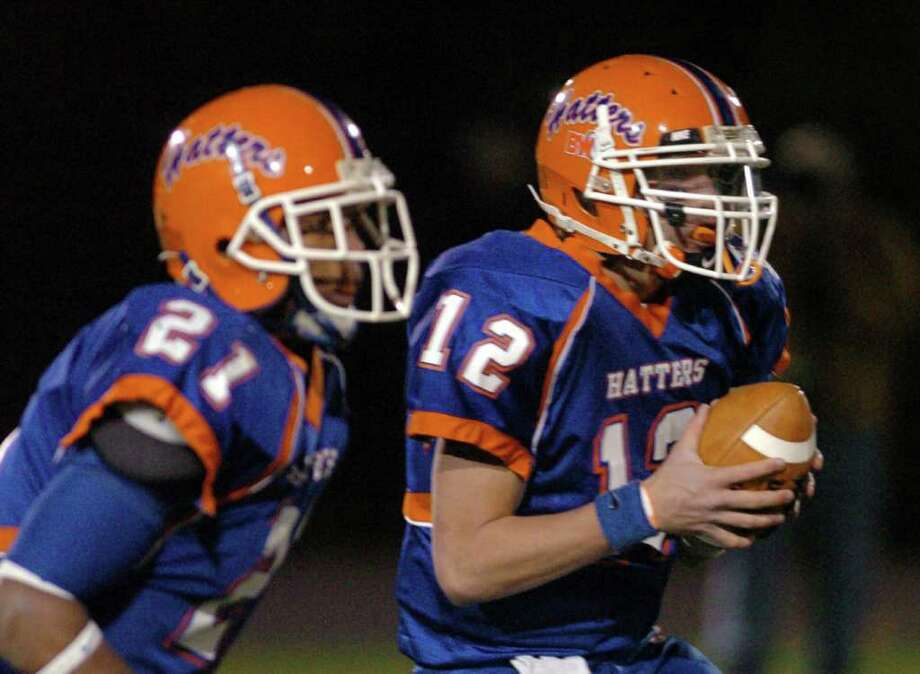 Danbury's 12, Nick Hammed sets up for a pass during the football game against Ridgefield at Danbury High School Nov. 24, 2010. Photo: Chris Ware / The News-Times