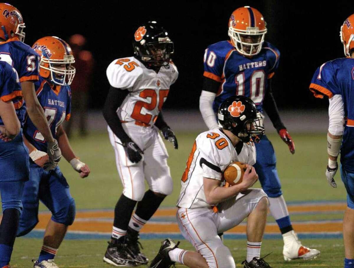 Ridgefield's 30, Sam Gravitte, receives a pass during the football game against Danbury at Danbury High School Nov. 24, 2010.