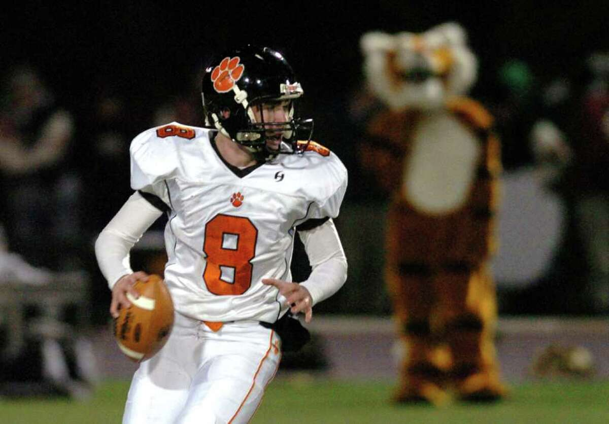 Ridgefield's 8, Connor Rowe, sets up for a pass during the football game against Danbury at Danbury High School Nov. 24, 2010.