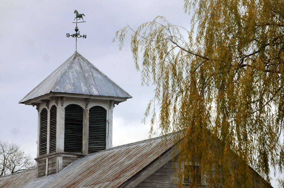 The cupola and weathervane are original to the horse barn, built circa 1901, on Walter and Paula Auclair's farm in Pittstown. (Cindy Schultz / Times Union)