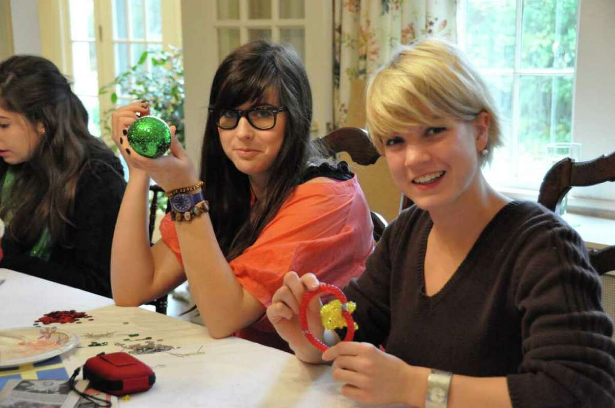 Au pairs Justine Forcina and Marina Schwarz from Germany make ornaments for last week's Festival of Trees, an annual charitable event which serves as the primary fundraiser for The Junior League of Greenwich. All proceeds from the event help to support their mission to fund community projects. The Greenwich au pairs will be making home-made decorations for our