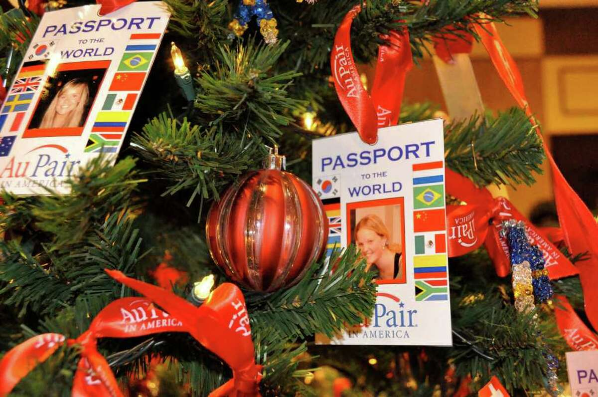 personalized Christmas Tree ornaments show participants in the Au Pair in America program.