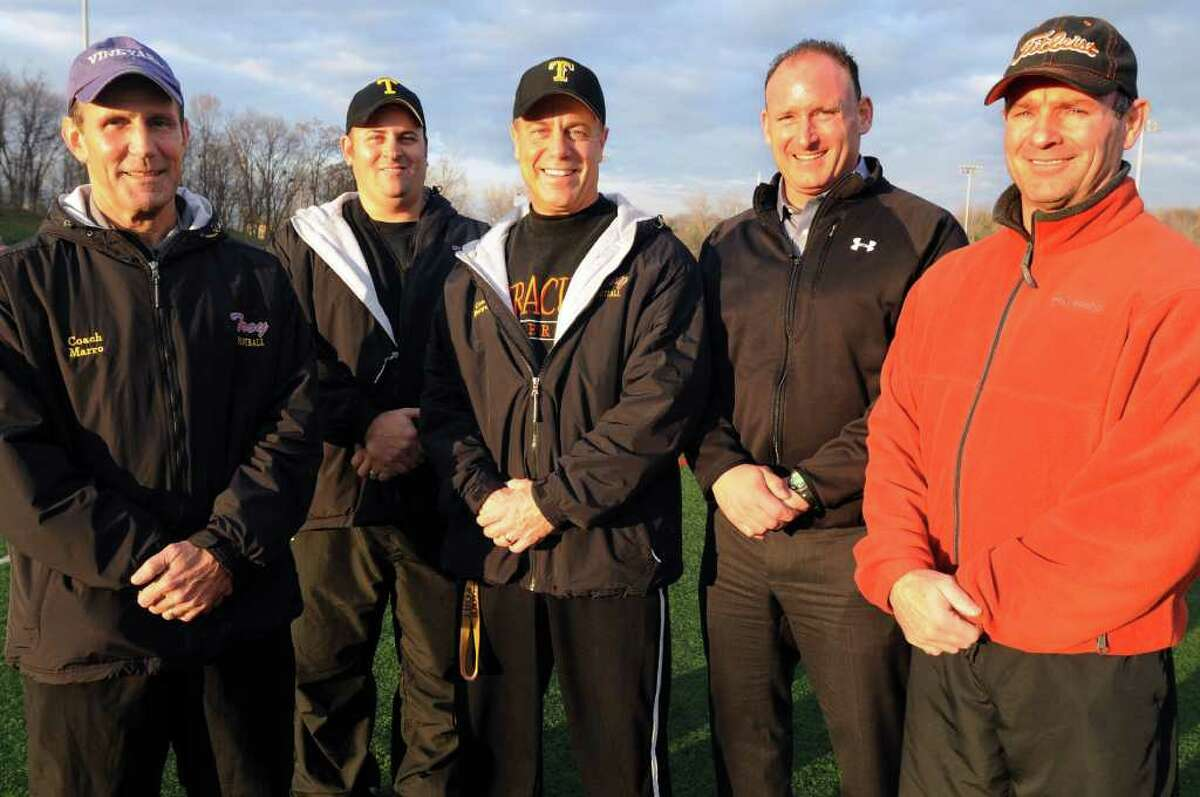 High school fall sports -- football -- Troy High head football coach Jack Burger, center, relies on the input from his assistant coaches, from left, Sam Marro, Bob Burns, Jim Canfield and Mark Galuski. (Cindy Schultz / Times Union)