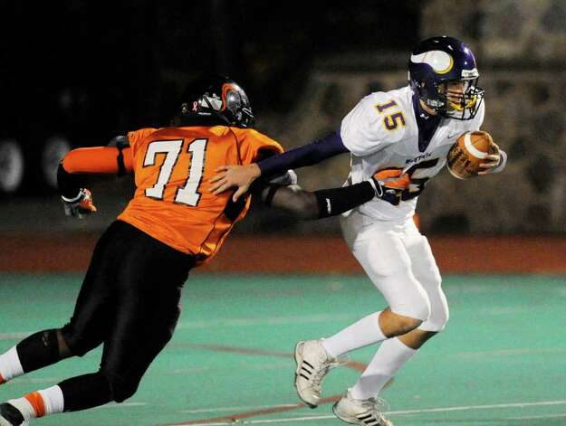 Shaquille Watkin, # 71 of Stamford High School, left, sacks Westhill quarterback Peter Cernansky, # 15, during lst quarter action of High School football game, Westhill High School vs. Stamford High School, Boyle Stadium, Stamford High School, Wednesday night, Nov. 24, 2010. Photo: Bob Luckey / Greenwich Time