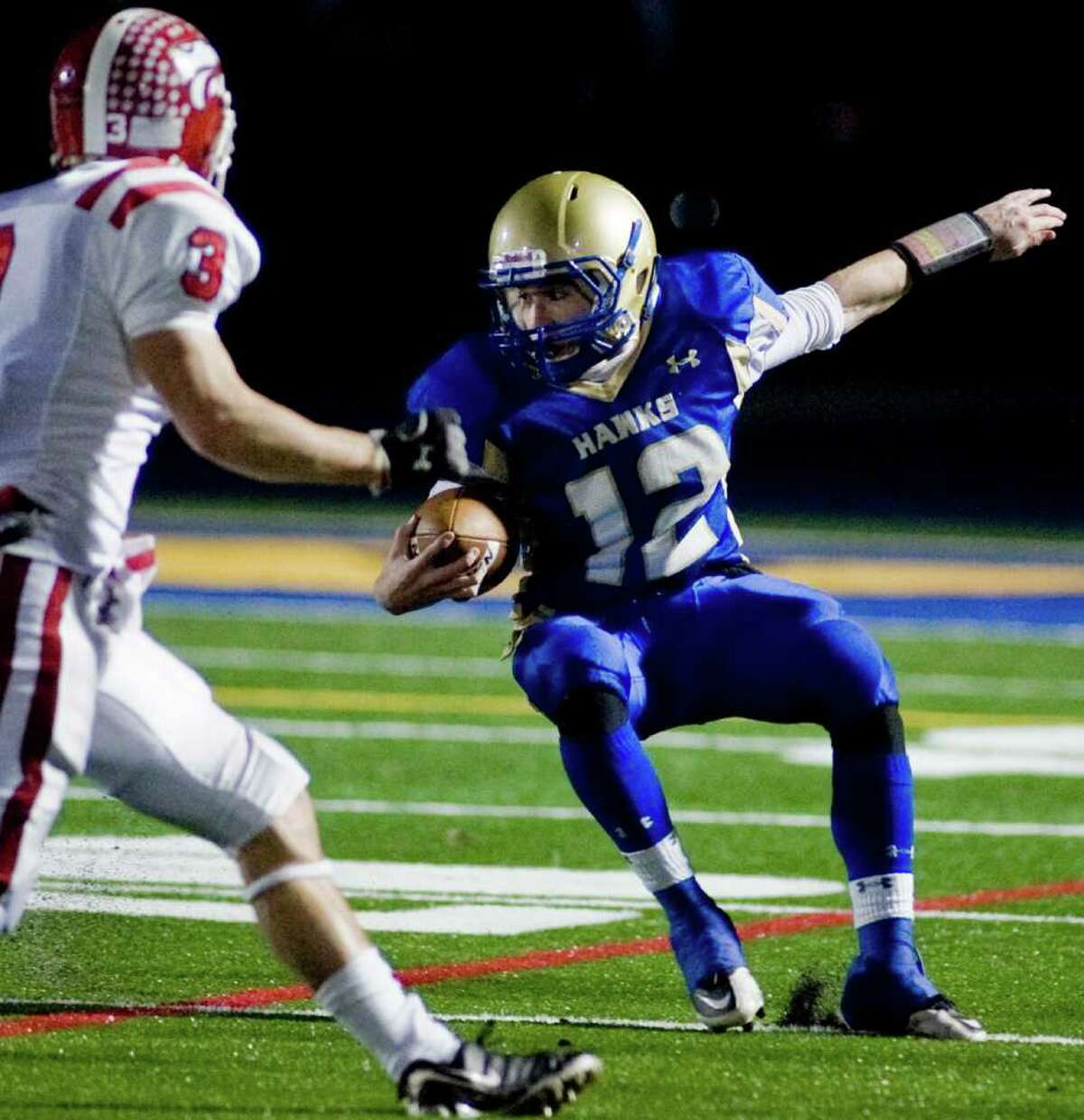 Newtown's Dan Hebert tries to get away during the SWC championship football game against Masuk at Newtown. Wednesday, Nov. 24, 2010