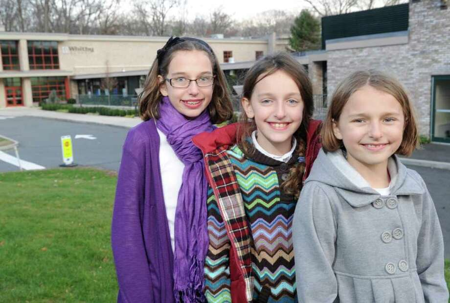 The Kavounas sisters, all of whom are Whitby School students, posed at the school, Greenwich, Wednesday afternoon, Nov. 24, 2010. They are, from left, Lizzie, 11, a fifth-grader, and twins Annie and Katie, both 9 and fourth-graders. Photo: Bob Luckey / Greenwich Time