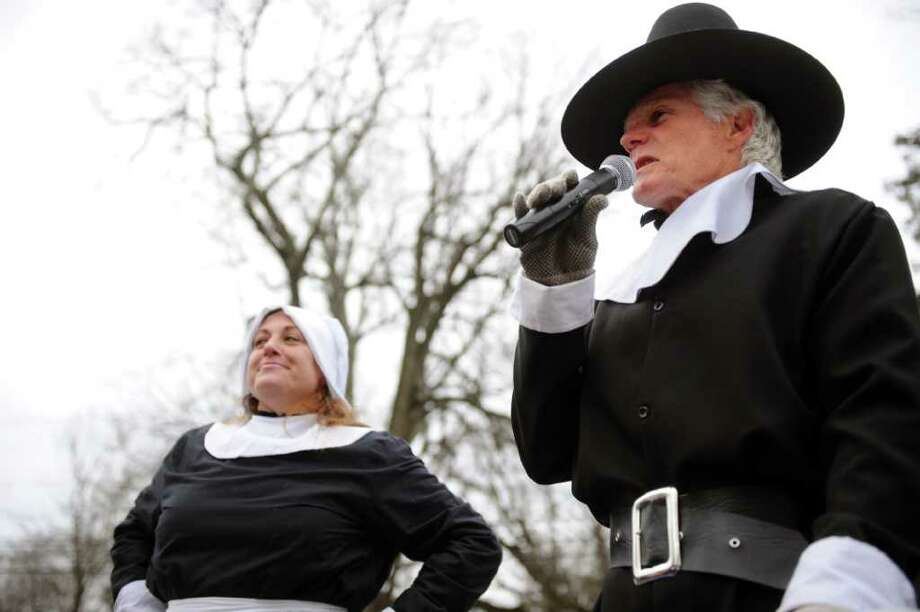 Ray Rodgers, right, speaks as a pilgrim before the start of the 33rd Pequot Running Club Thanksgiving Day five-mile race in Southport on November 25, 2010. Photo: Lindsay Niegelberg / Connecticut Post