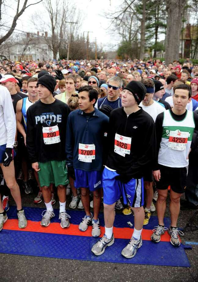 Runners line up to start before the 33rd Pequot Running Club Thanksgiving Day five-mile race in Southport on November 25, 2010. Photo: Lindsay Niegelberg / Connecticut Post