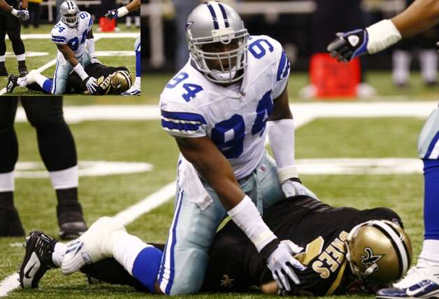 Linebacker DeMarcus Ware of the Dallas Cowboys sacks quarterback Drew Brees of the Saints at the Louisiana Superdome, Dec. 19, 2009 in New Orleans.