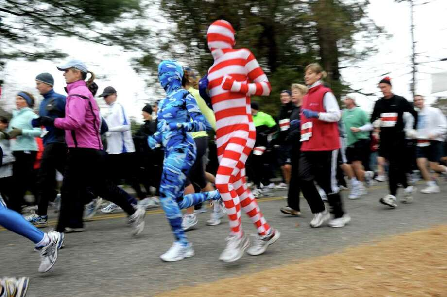 Runners participate in the 33rd Pequot Running Club Thanksgiving Day five-mile race in Southport on November 25, 2010. Photo: Lindsay Niegelberg / Connecticut Post