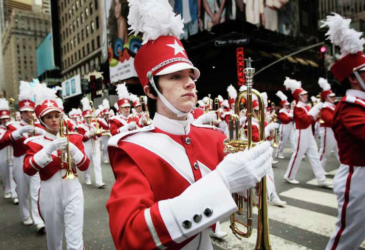 NEW YORK - NOVEMBER 25: A marching band heads south to Times Square during the Macy's Thanksgiving Day parade November 25, 2010 in New York City. The 84th annual celebration featured approximately 8,000 participants including more 1,600 cheerleaders and dancers, twelve marching bands, and an assortment of celebrities in addition to 15 giant character balloons. (Photo by Chris Hondros/Getty Images)