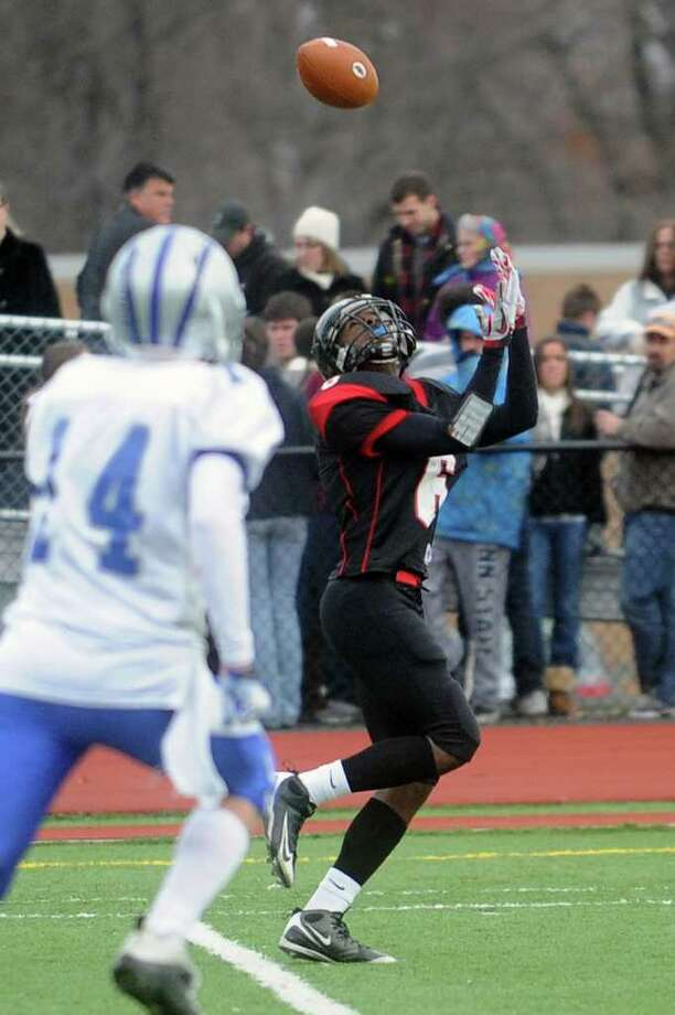 Warde's Terrell Walden reaches for a pass that falls incomplete during Thursday's Thanksgiving Day game against Fairfield Ludlowe at Fairfield Warde High School on November 25, 2010. Photo: Lindsay Niegelberg / Connecticut Post